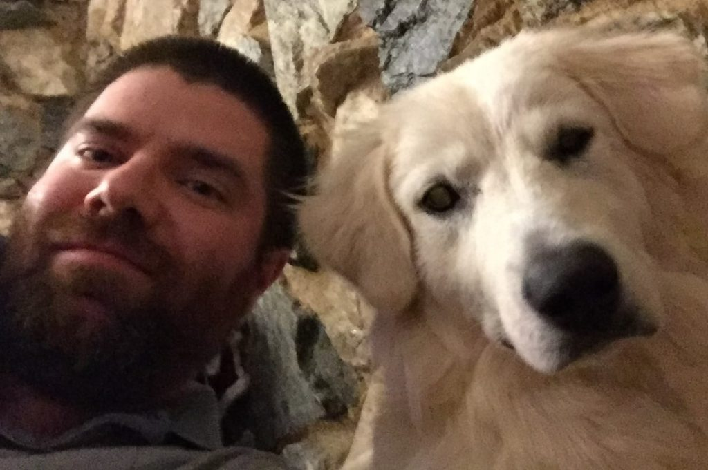 The game designer and president of our indie studio plays with his dog, a huge Great Pyrenees with white fur.
